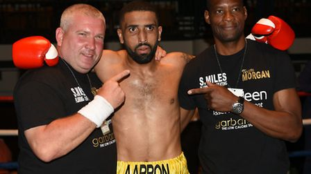 Aarron Morgan with trainers Bevis Allen (right) and Roy Callaghan after stopping Gyula Vajda in the