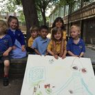 Children from Highbury Quadrant school with their plans for a new playground