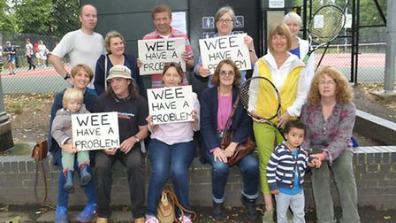 Cllr Carloine Russell and local residents outside the toilet