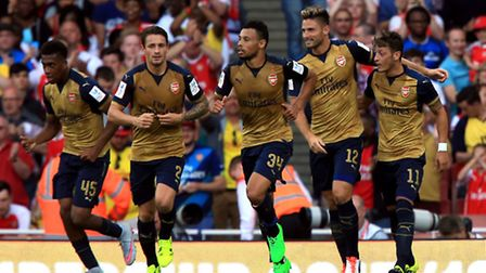 Olivier Giroud (second right) celebrates scoring Arsenal's first goal against Lyon in the Emirates C