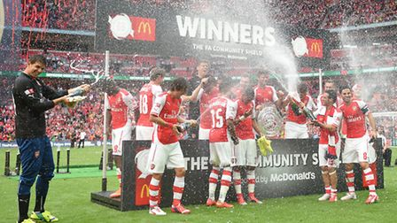 Arsenal celebrate with the Community Shield after their 3-0 win over Manchester City in 2014