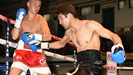 Georgie Kean (red/white shorts) in action against Faheem Khan at York Hall, Bethnal Green. Pic: Phil