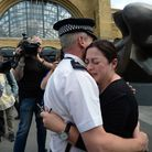 7/7 survivor Gill Hicks hugs PC Andy Maxwell, who came to her aid when she was injured at Kings Cros
