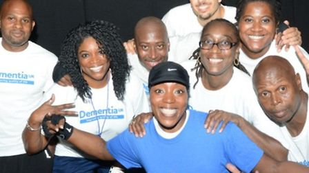 Mrs Etienne-Thomas flashes a smile with fellow fundraisers at the Bridge Park Community Leisure Cent