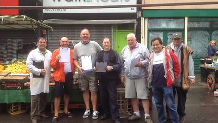 David Twydale, second left, with other traders outside his fruit stall