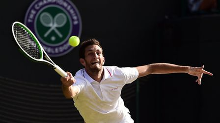 James Ward in action during his third-round match against Vasek Pospisil at Wimbledon