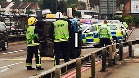 The car flipped on its side (Pic credit: Francis Henry)