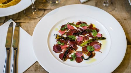 Grilled miso-cured beef with ginger, sweet radish and burnt onion