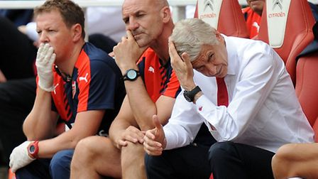 Arsenal manager Arsene Wenger (right) during the 2-0 defeat to West Ham