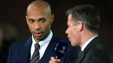 Sky Sports pundit Thierry Henry (left) listens to Jamie Carragher. Picture: PA/Mike Egerton