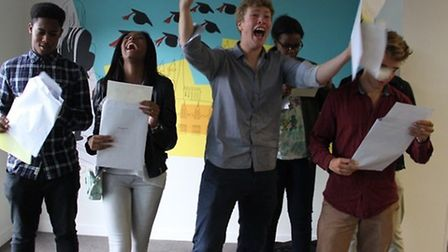 Students at Ark Academy celebrate success in their GCSE results this morning