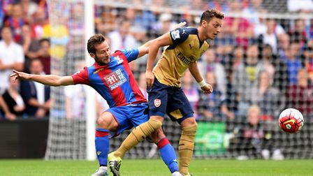 Crystal Palace's Yohan Cabaye (left) battles for the ball with Arsenal's Mesut Ozil at Selhurst Park