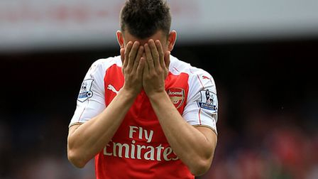 Arsenal's Laurent Koscielny reacts to their defeat by West Ham