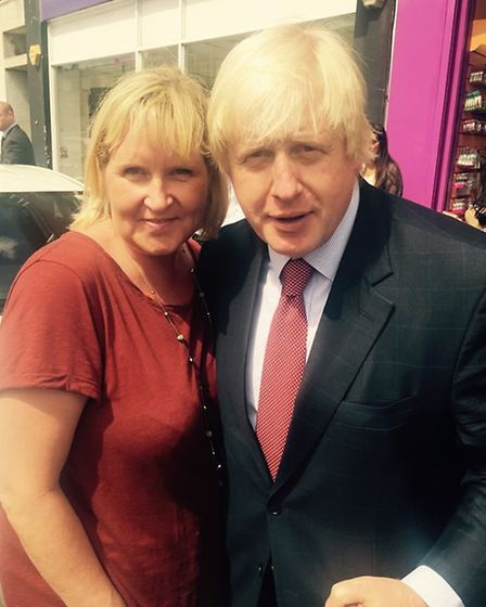 Boris Johnson with Noreen Buckley owner of the Buckley Bar on Streatfield Road, while on a visit to