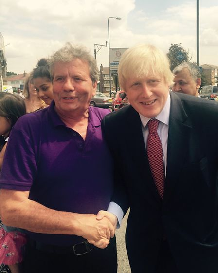 Boris Johnson with Tommy Shea from Galway, while on a visit to Egg Free Cakes on Streatfield Road