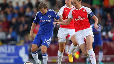 Casey Stoney of Arsenal Ladies (right) tries to put Chelsea's Fran Kirby under pressure