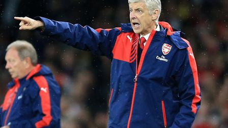 Arsenal manager Arsene Wenger gestures on the touchline against Liverpool.