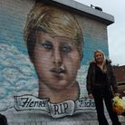 Claudia Hicks stands in front of the finished mural of her brother Henry who died aged 18