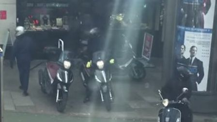 The riders parked their bikes on the pavement while carrying out the robbery