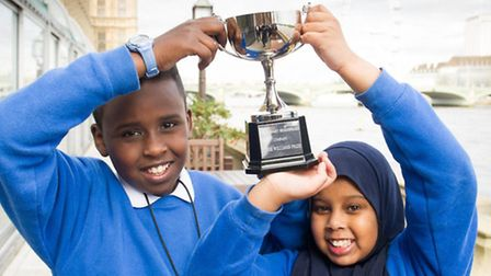 Ayub Abdalla and Aisha Bahdoon from Harlesden Primary School hold aloft the winning trophy for all t