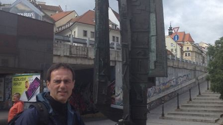 Mr Lorber stands next to a Jewish holocaust memorial in Bratislava, now the capital of Slovakia, dur