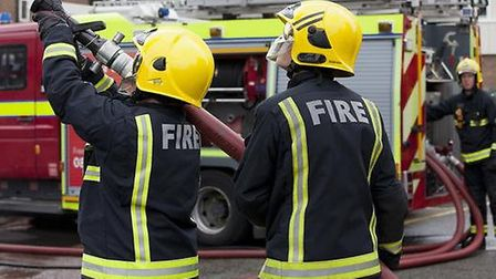 Firefighters put out fire which took hold in the roof of St Joseph's Primary School in Harlesden p