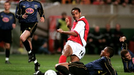 Thierry Henry of Arsenal terrorises the Lens defence and narrowly misses with this shot. Picture: PA
