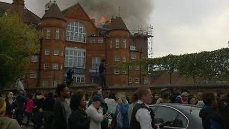 Pupils, parents and teachers were seen crying as they watched the roof of the school building collap