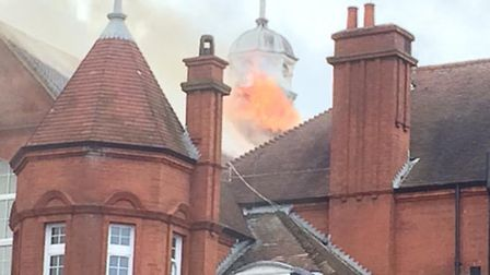 Fire crews battled flames as they billowed from the roof of the school building