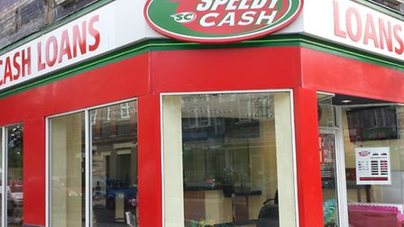 """Campaigners for Just money were """"delighted"""" after posters and banners were removed from Speedy Cash"""