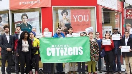 The campaigners protested against the adverts outside of Speedy Cash last month (Credit: Adam Thomas