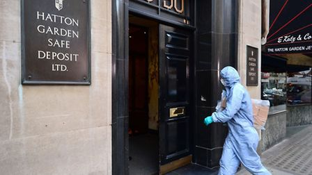 A police forensics officer enters the Hatton Garden Safe Deposit company following the raid. Domini