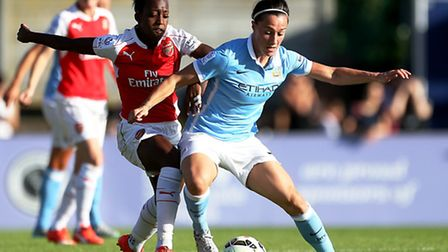 Arsenal Ladies' Dani Carter (left) battles with Lucy Bronze of Manchester City Women