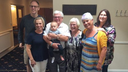 Four generations celebrate the anniversary at a party last weekend. (Left to right:) Craig Saunders