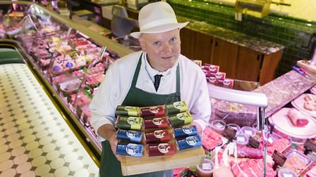 Highbury butcher Chris Godfrey with the protein bars at his shop.
