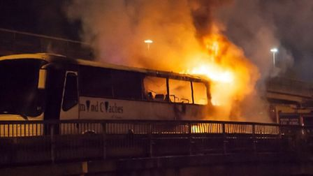 Flames tore through the Diamond Coaches vehicle after a fire broke out at around 2:30am (Pic credit: