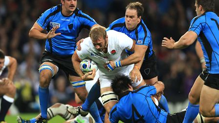 England's Chris Robshaw is tackled by Uruguay's Santiago Vilaseca (right) during the Rugby World Cup