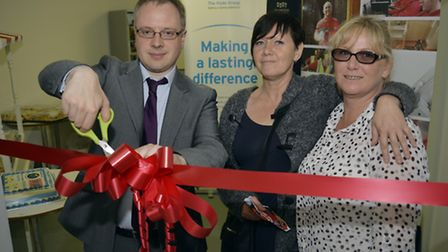 Cllr Watts cuts the ribbon with Frances Punter and Tracey Breslin of the tenants and residents grou