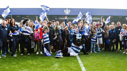 Rangers supporters and members of the QPR Tiger Cubs on the pitch at Loftus Road on Saturday. Pic: B