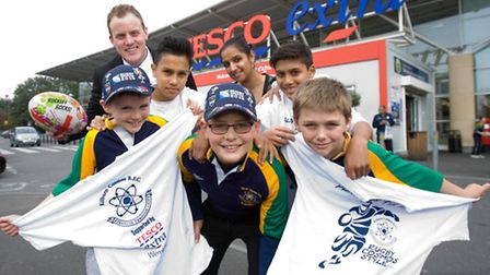 Rugby World Cup (RWC) Fun Day - Tesco Extra Wembley deputy manager Kay Coggins and Community Champ N