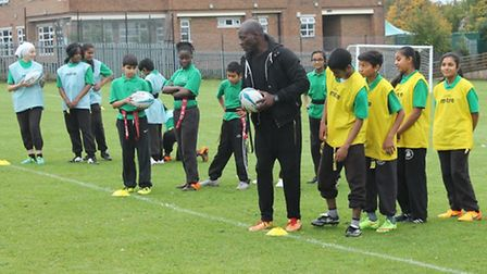 England rugby champion Martin Offiah with year eight pupils at Alperton Community School