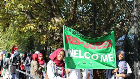Students from Islamia school held banners aloft in support of refugees arriving in Europe from war-t