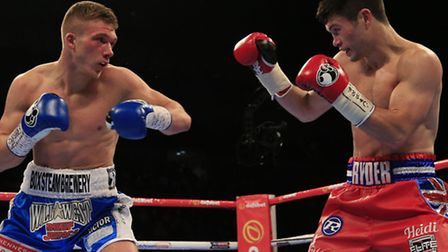 John Ryder (right) in action against Nick Blackwell in ttheir British middleweight title fight at th