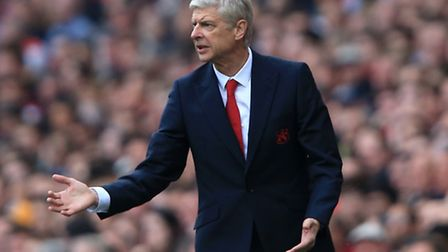 Arsenal manager Arsene Wenger gestures on the touchline during the 3-0 win over Manchester United