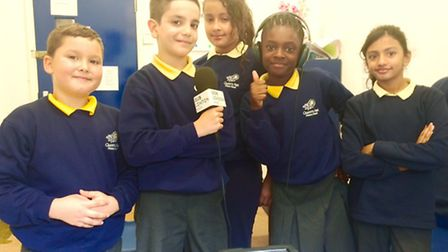 Pupils from Queens Park Primary School took on the roles of journalists