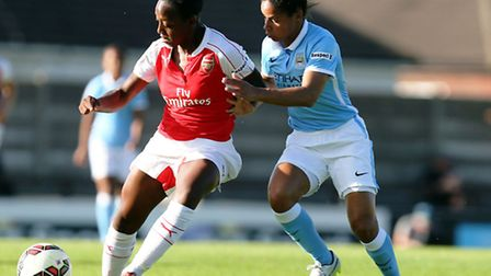 Arsenal's Dani Carter (left) in action against Manchester City Women