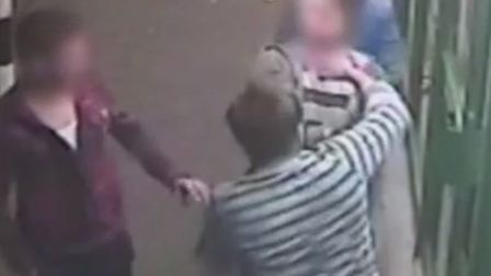 The CCTV footage shows the van driver being punched in the face