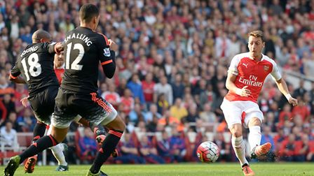 Arsenal's Mesut Ozil scores their second goal against Manchester United