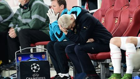 Arsenal manager Arsene Wenger sits on the bench dejected during the UEFA Champions League game again