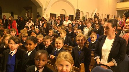 Pupils, parents and staff at St Joseph's RC primary school gathered at the church of Our Lady of Wil